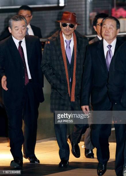 "Kenichi Shinoda , the boss of Japan's largest ""yakuza"" gang, the Yamaguchi-gumi, walks at Tokyo's Shinagawa station to return to his his home in..."