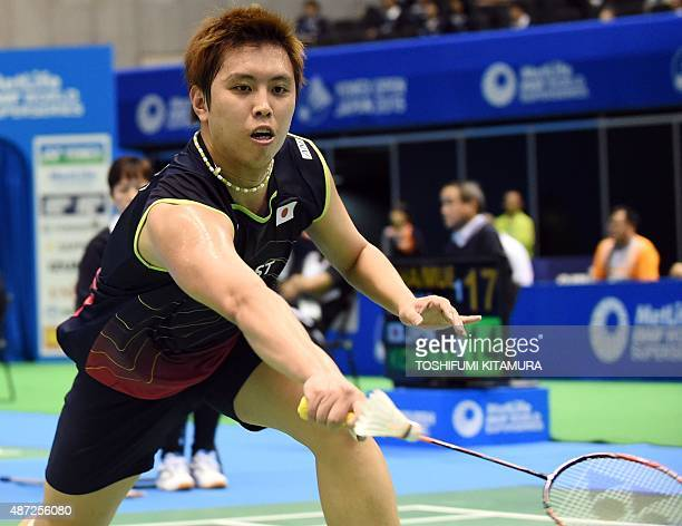Kenichi Tago of Japan returns the shuttle cock towards Lee DongKeun of South Korea during their Open Japan badminton tournament qualification round 1...