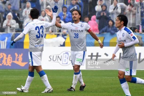 Kenji Baba of Oita Trinita celebrates scoring his side's first goal during the J.League J2 match between Yokohama FC and Oita Trinita at Nippatsu...
