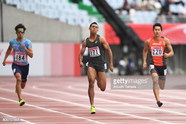 Kenji Fujimitsu Abdul Hakim Sani Brown and Shota Iizuka of Japan compete in the men 200m final during the 101st Japan National Championships at...