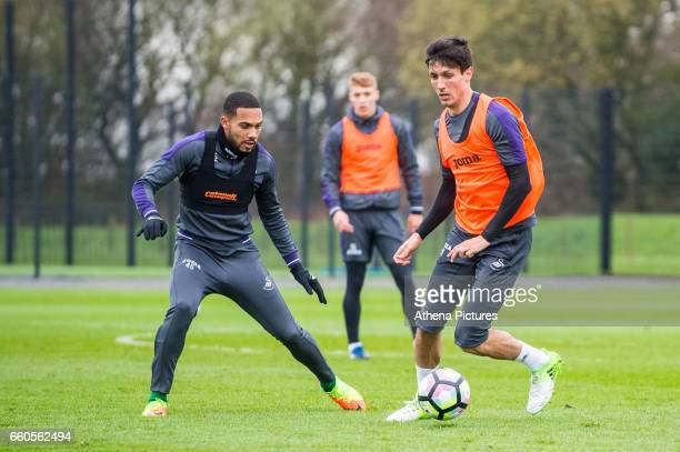 Kenji Gorre and Jack Cork in action during the Swansea City training session at The Fairwood training Ground on March 30 2017 in Swansea Wales