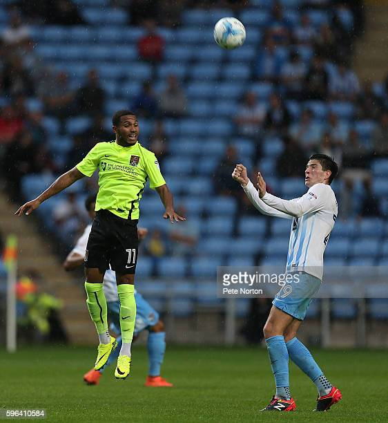 Kenji Gorre of Northampton Town contests the ball with Cian Harries of Coventry City during the Sky Bet League One match between Coventry City and...