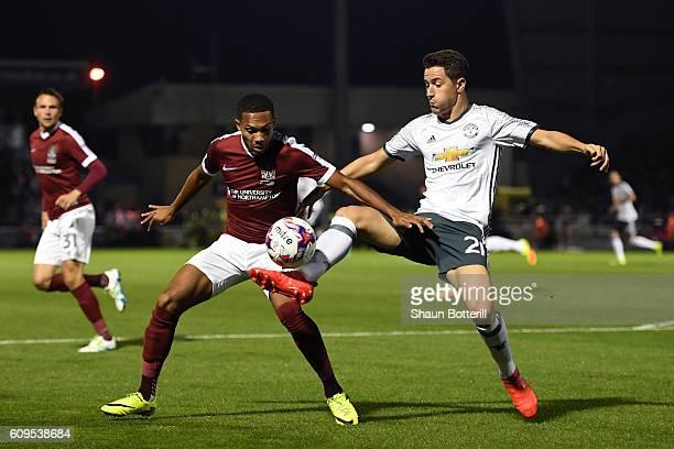 Kenji Gorre of Northampton Town in action with Ander Herrera of Manchester United during the EFL Cup Third Round match between Northampton Town and...