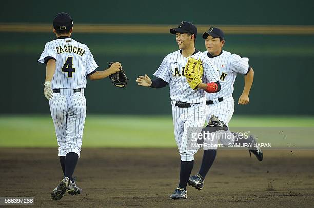 Kenji Inoh celebrates with team mates in the top half of the second inning in the super round game between Japan and Panama during The 3rd WBSC U-15...