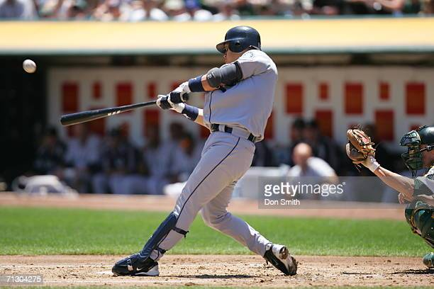 Kenji Johjima of the Seattle Mariners bats during the game against the Oakland Athletics at the Network Associates Coliseum in Oakland California on...