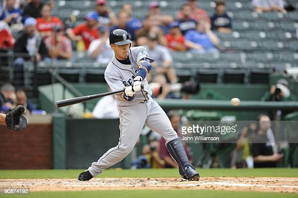 Kenji Johjima of the Seattle Mariners bats during the game against the Texas Rangers at Rangers Ballpark in Arlington in Arlington Texas on Sunday...