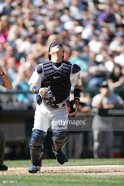 Kenji Johjima of the Seattle Mariners catches a foul pop during the game against the New York Yankees at Safeco Field on August 16 2009 in Seattle...