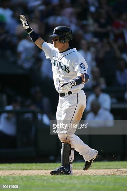 Kenji Johjima of the Seattle Mariners celebrates at home plate during the game against the New York Yankees at Safeco Field on August 16 2009 in...