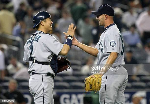Kenji Johjima of the Seattle Mariners celebrates the win with pitcher David Aardsma against the New York Yankees on July 2 2009 at Yankee Stadium in...