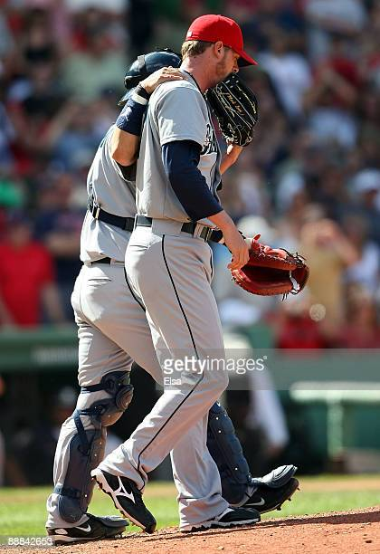 Kenji Johjima of the Seattle Mariners consoles Mark Lowe after a rough seventh inning on July 5 2009 at Fenway Park in Boston Massachusetts The Red...