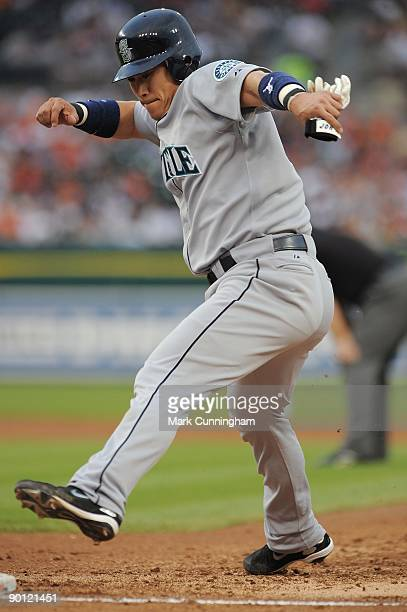Kenji Johjima of the Seattle Mariners gets back to the base against the Detroit Tigers during the game at Comerica Park on August 19 2009 in Detroit...