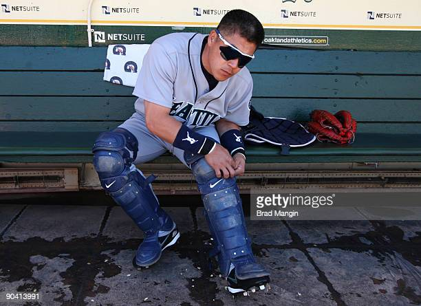 Kenji Johjima of the Seattle Mariners gets ready in the dugout putting on his catchers gear before the game against the Oakland Athletics at the...