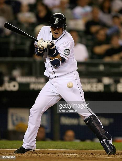 Kenji Johjima of the Seattle Mariners is hit by a pitch in the fourteenth inning against the Chicago White Sox on September 17 2009 at Safeco Field...