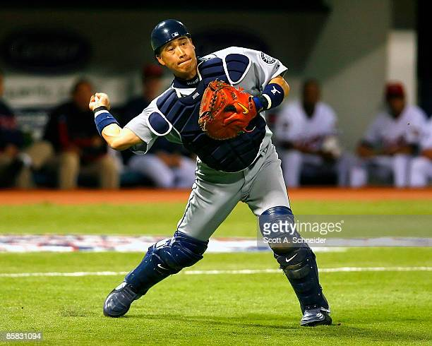 Kenji Johjima of the Seattle Mariners picks up a bunt by Denard Span of the Minnesota Twins and throws him out on Opening Day at the Metrodome on...