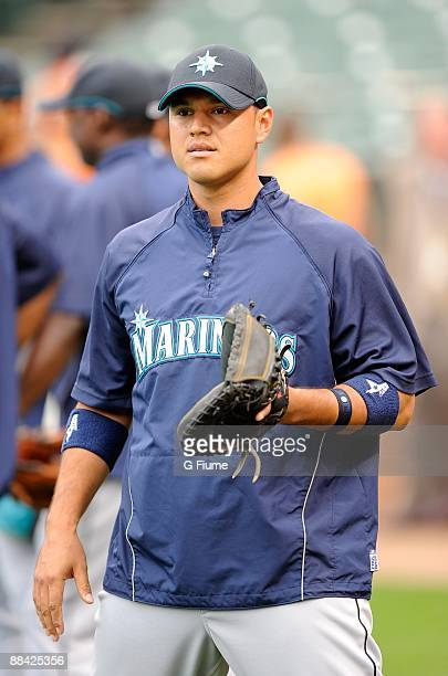 Kenji Johjima of the Seattle Mariners warms up before the game against the Baltimore Orioles at Camden Yards on June 10 2009 in Baltimore Maryland