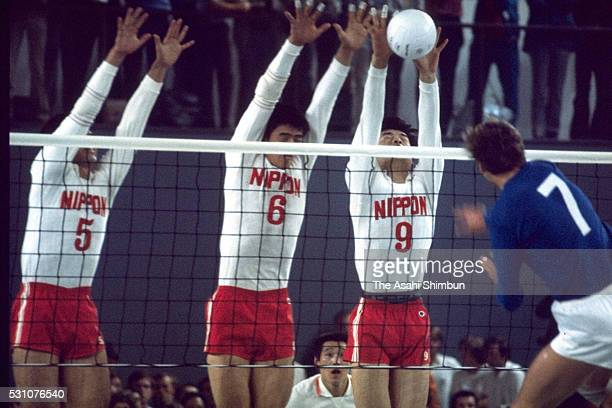 Kenji Kimura, Yoshihide Fukao and Tadayoshi Yokota of Japan block the spike in the Volleyball Men's final match between East Germany and Japan at...