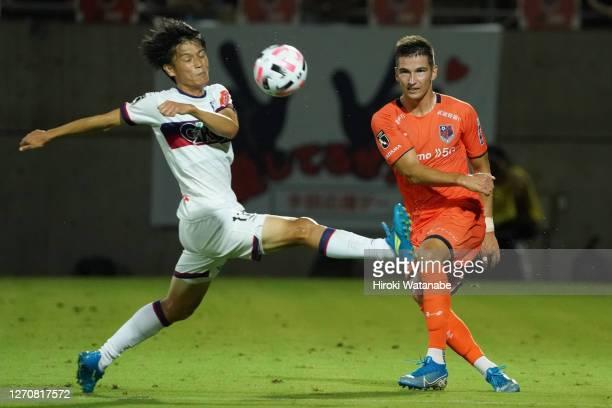 Kenji Sekido of Fagiano Okayama and Vitalijs Masimenko of Omiya Ardija compete for the ball during the J.League Meiji Yasuda J2 match between Omiya...