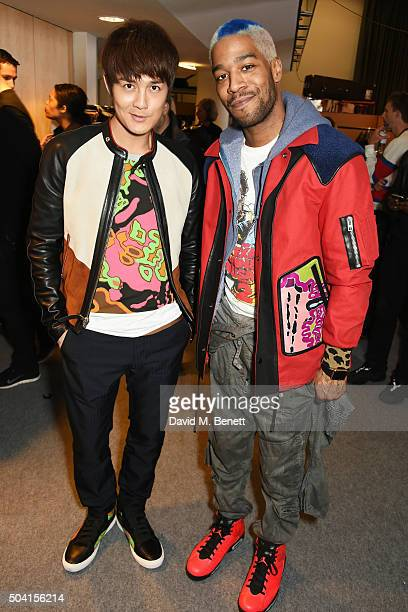 Kenji Wu and Kid Cudi attend the Coach FW16 show front row during London Collections Men at The Lindley Hall on January 9 2016 in London England