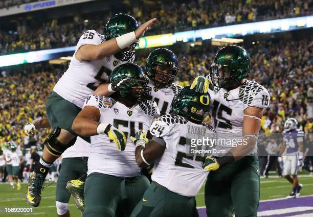Kenjon Barner of the Oregon Ducks celebrates his second quarter touchdown against the Kansas State Wildcats with teammates during the Tostitos Fiesta...