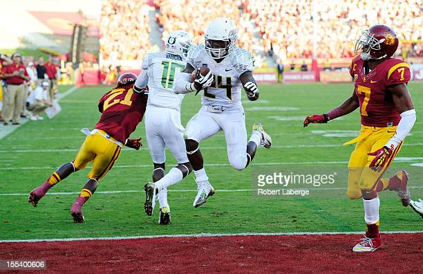 Kenjon Barner of the Oregon Ducks runs by T J McDonald of the USC Trojans for a touchdown in the first half at Los Angeles Memorial Coliseum on...