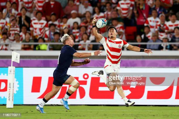 Kenki Fukuoka of Japan beats Darcy Graham of Scotland to score their third try during the Rugby World Cup 2019 Group A game between Japan and...