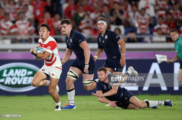 Kenki Fukuoka of Japan breaks clear from Finn Russell of Scotland to score their fourth try during the Rugby World Cup 2019 Group A game between...