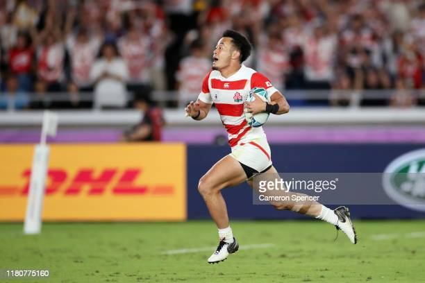 Kenki Fukuoka of Japan breaks clear to score their fourth try during the Rugby World Cup 2019 Group A game between Japan and Scotland at...
