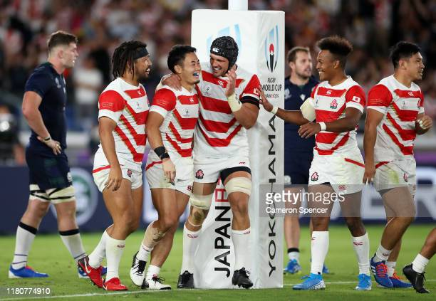 Kenki Fukuoka of Japan celebrates as he scores their fourth try with team mates during the Rugby World Cup 2019 Group A game between Japan and...