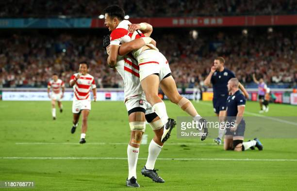Kenki Fukuoka of Japan celebrates with team mate Pieter Labuschagne as he scores their third try during the Rugby World Cup 2019 Group A game between...