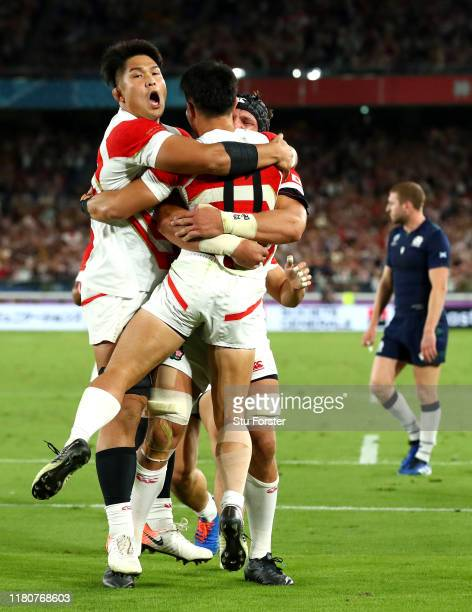 Kenki Fukuoka of Japan celebrates with team mates as he scores their third try during the Rugby World Cup 2019 Group A game between Japan and...