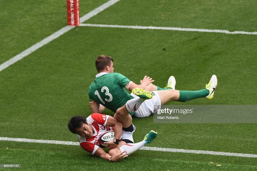 Kenki Fukuoka of Japan competes for the ball against Garry Ringrose of Ireland during the international rugby friendly match between Japan and Ireland at Ajinomoto Stadium on June 24, 2017 in Tokyo, Japan.