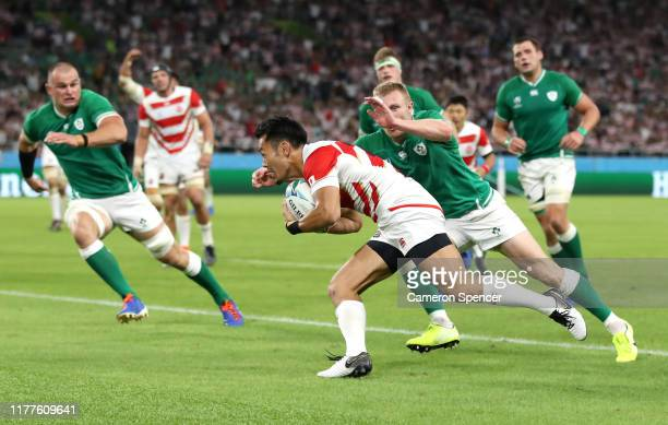 Kenki Fukuoka of Japan dives to score his side's first try during the Rugby World Cup 2019 Group A game between Japan and Ireland at Shizuoka Stadium...