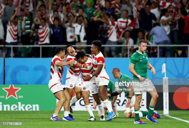 Kenki Fukuoka of Japan is congratulated by his team mates after scoring his side's first try during the Rugby World Cup 2019 Group A game between...