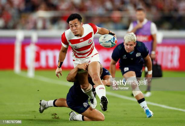 Kenki Fukuoka of Japan is tackled by Chris Harris of Scotland during the Rugby World Cup 2019 Group A game between Japan and Scotland at...
