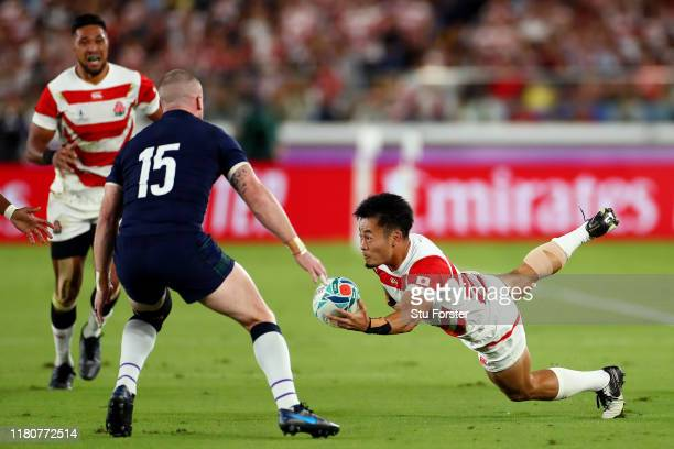 Kenki Fukuoka of Japan passes to Kotaro Matsushima of Japan for their first try as Stuart Hogg of Scotland looks on during the Rugby World Cup 2019...