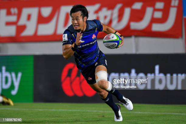 Kenki Fukuoka of Japan runs with the ball to score his side's fifth try during the Pacific Nations Cup match between Japan and Tonga at Hanazono...