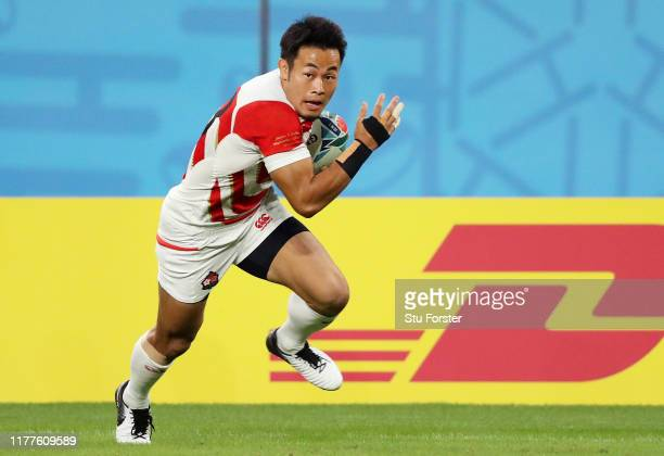 Kenki Fukuoka of Japan runs with the ball to score his side's first try during the Rugby World Cup 2019 Group A game between Japan and Ireland at...