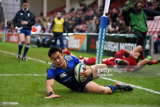 Kenki Fukuoka of Japan scores a try during the International Friendly match between Russia and Japan at Kingsholm Stadium on November 24, 2018 in...