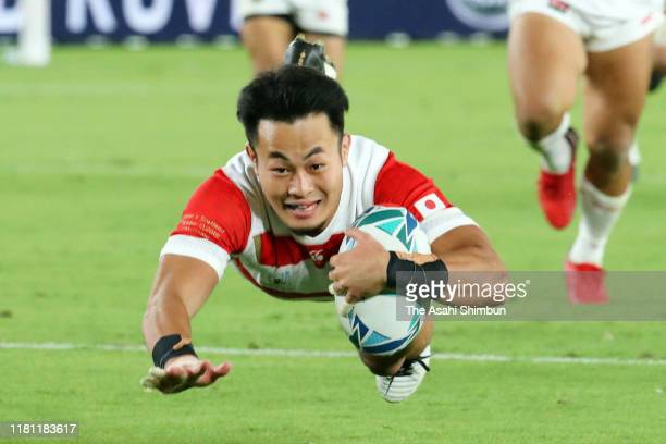 Kenki Fukuoka of Japan scores his side's third try during the Rugby World Cup 2019 Group A game between Japan and Scotland at International Stadium...