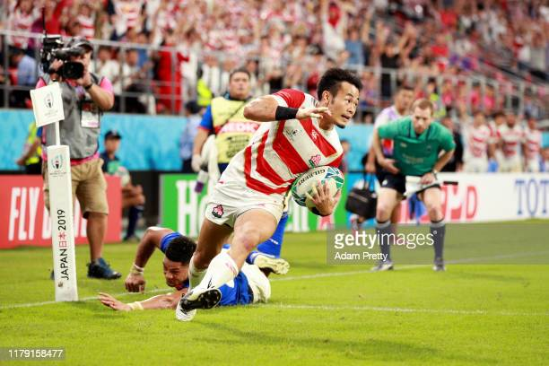Kenki Fukuoka of Japan scores his teams third try during the Rugby World Cup 2019 Group A game between Japan and Samoa at City of Toyota Stadium on...