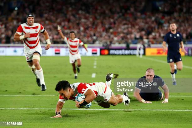Kenki Fukuoka of Japan touches down to score their third try as Stuart Hogg of Scotland looks on during the Rugby World Cup 2019 Group A game between...