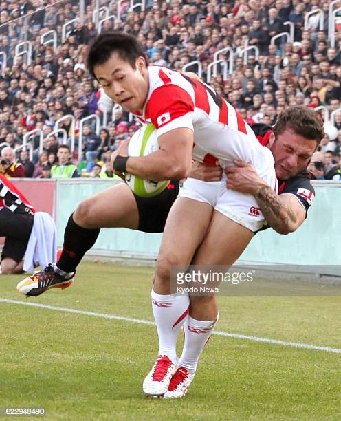 Kenki Fukuoka of Japan's national rugby team scores a try in the second half of a test match against Georgia in Tbilisi on Nov 12 2016 Japan picked...