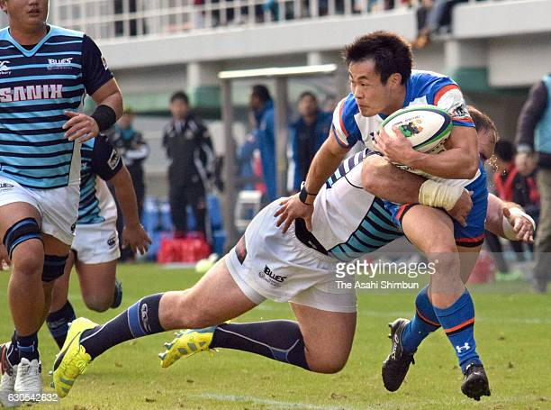 Kenki Fukuoka of Panasonic Wild Knights is tackled during the Rugby Top League match between Munakata Sanix Blues and Panasonic Wild Knights at Level...