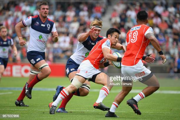 Kenki Fukuoka of the Sunwolves is tackled by Angus ScottYoung of the Reds during the Super Rugby match between Sunwolves and Reds at Prince Chichibu...