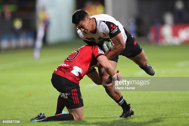 Kenki Fukuoka of the Sunwolves is tackled by Mike Delany of the Crusaders during the round 10 Super Rugby match between the Crusaders and the...