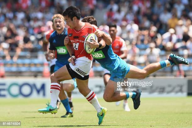 Kenki Fukuoka of the Sunwolves is tackled during the Super Rugby match between the Sunwolves and the Blues at Prince Chichibu Stadium on July 15 2017...