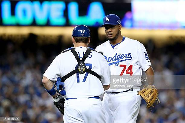 Kenley Jansen and AJ Ellis of the Los Angeles Dodgers celebrate after the Dodgers defeat the St Louis Cardinals 30 in Game Three of the National...