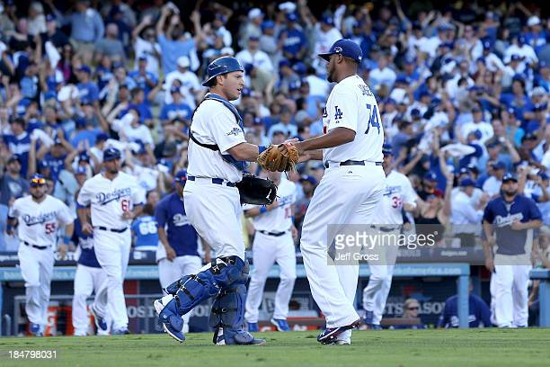 Kenley Jansen and AJ Ellis of the Los Angeles Dodgers celebrate after the Dodgers defeat the St Louis Cardinals 64 in Game Five of the National...