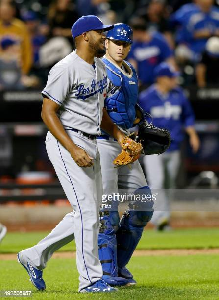 Kenley Jansen and AJ Ellis of the Los Angeles Dodgers celebrate the 94 win over the New York Mets on May 20 2014 at Citi Field in the Flushing...