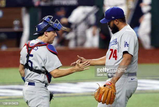 Kenley Jansen and Austin Barnes of the Los Angeles Dodgers celebrate the teams 6-2 victory against the Tampa Bay Rays in Game Three of the 2020 MLB...